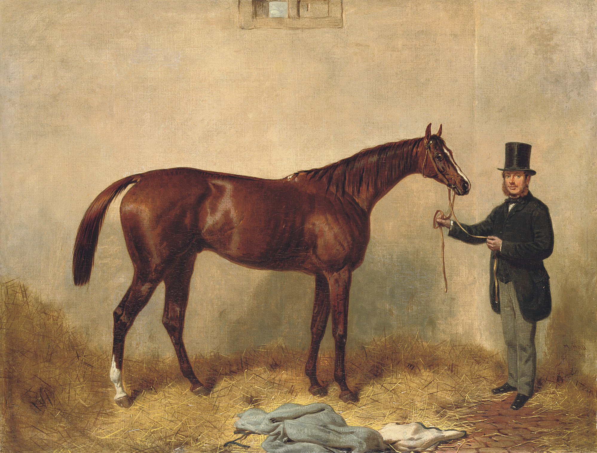 Loiterer, held by a trainer in a stable