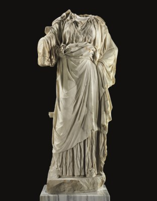 A ROMAN MARBLE FIGURE OF A WOM