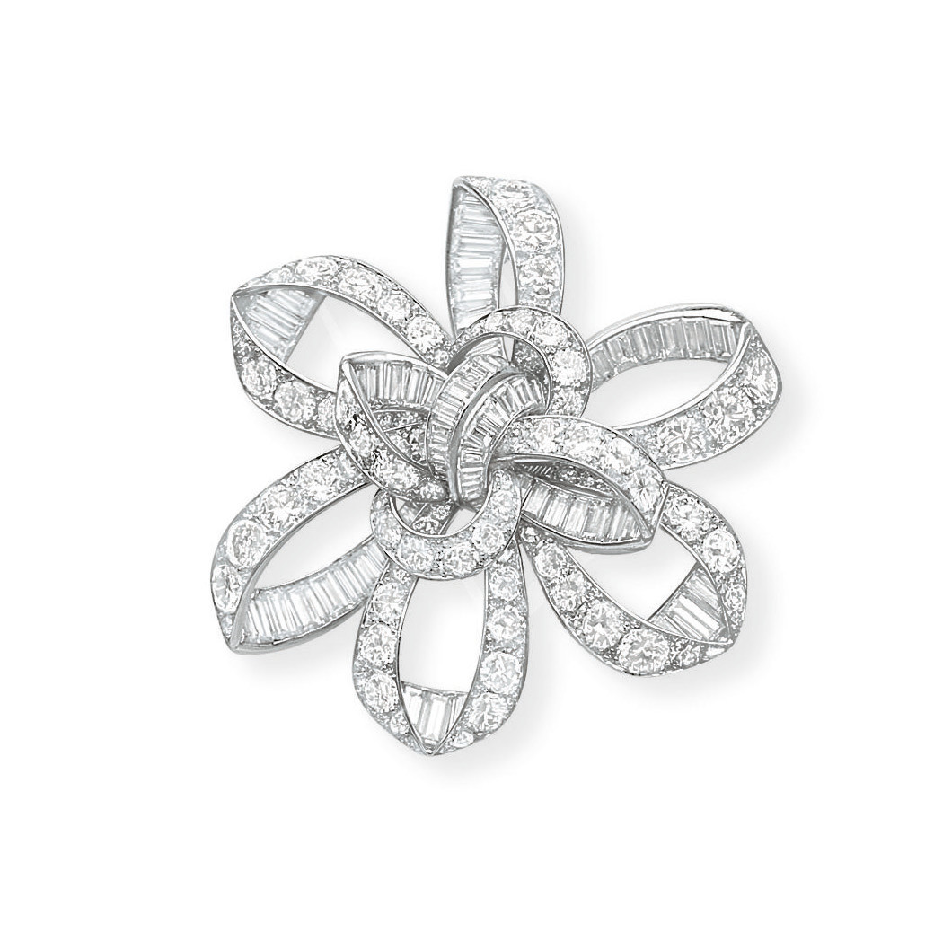 A STYLISH DIAMOND BROOCH, BY JOHN RUBEL