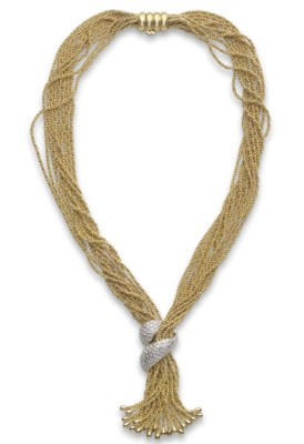 A GOLD AND DIAMOND TASSEL NECK