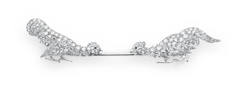 AN ART DECO DIAMOND JABOT PIN,