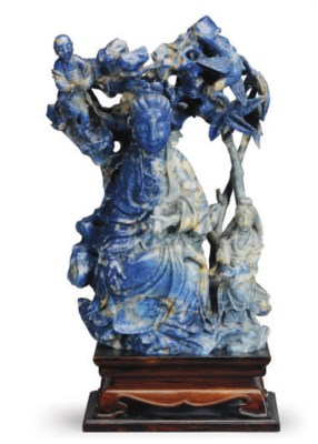 A CHINESE CARVED SODALITE GUAN