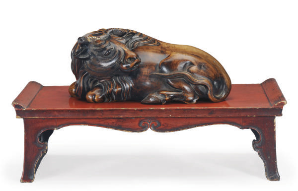 A CHINESE CARVED HARDWOOD FIGU
