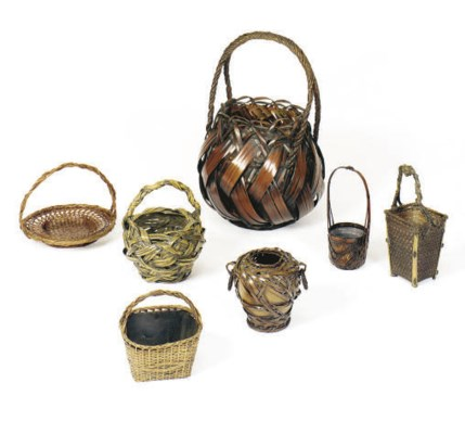 A GROUP OF SEVEN WOVEN BASKETS