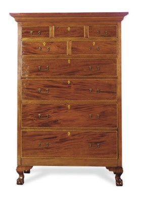 AN INLAID MAHOGANY TALL CHEST-