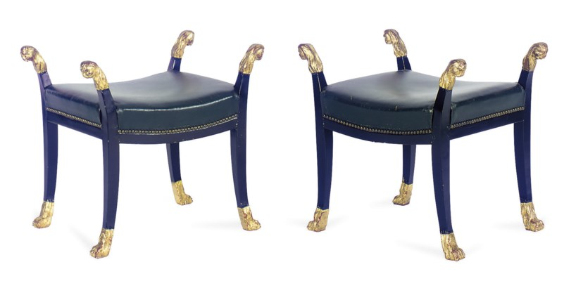 A PAIR OF EBONIZED AND PARCEL-