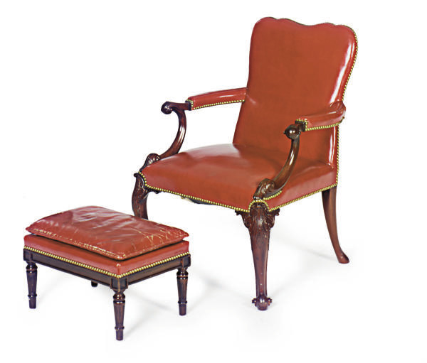 A CARVED MAHOGANY AND RED LEAT