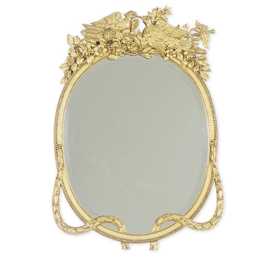 A GILTWOOD OVAL MIRROR,