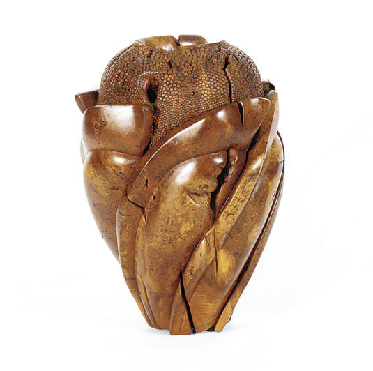 A CARVED WOOD VASE,