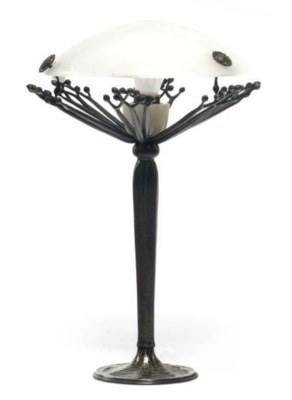 A WROUGHT IRON AND ALABASTER T