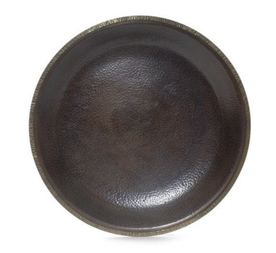 A HAMMERED COPPER CHARGER,