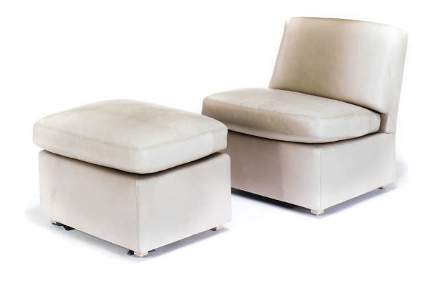 A LEATHER UPHOLSTERED CHAIR AN
