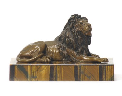 A PATINATED BRONZE FIGURAL PAP