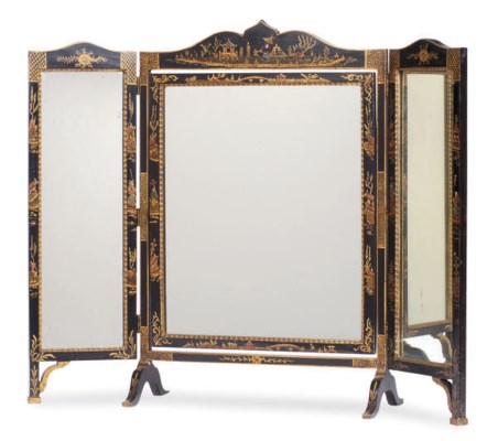 A BLACK AND GILT-LACQUERED DRE