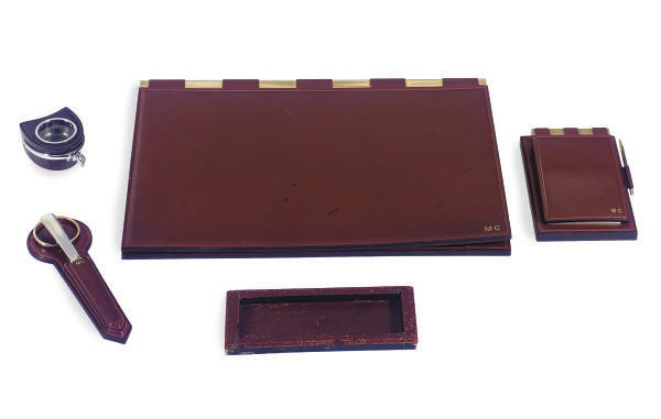 A FRENCH LEATHER DESK SET,