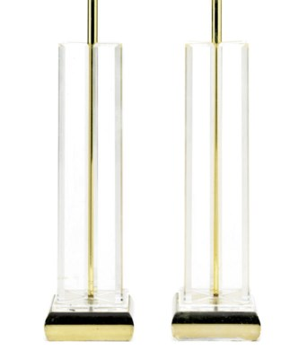 A pair of tall lucite table la