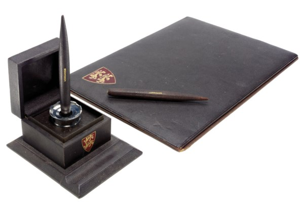 A brown leather desk set for t