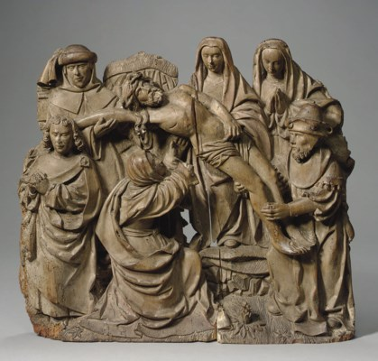 A CARVED LIMEWOOD RELIEF OF TH