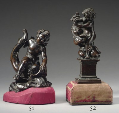 A BRONZE GROUP OF TWO PUTTI
