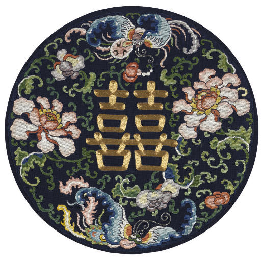 AN EMBROIDERED ROUNDEL FROM A