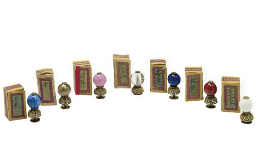 A GROUP OF SEVEN HAT BUTTONS A