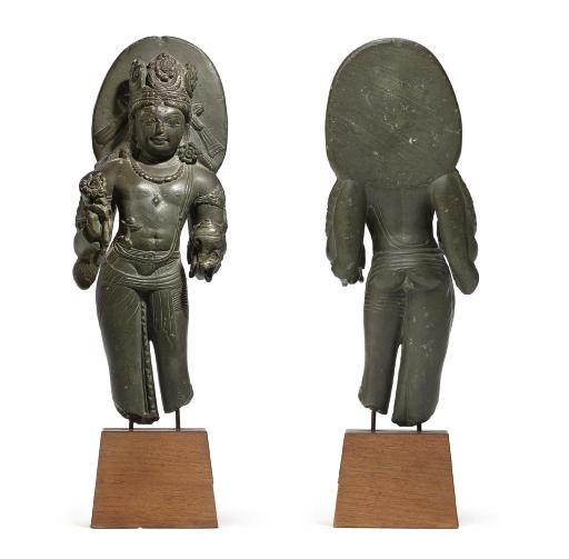 A rare green stone figure of Vishnu