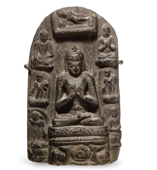 A small stone stele of Buddha with scenes from his life