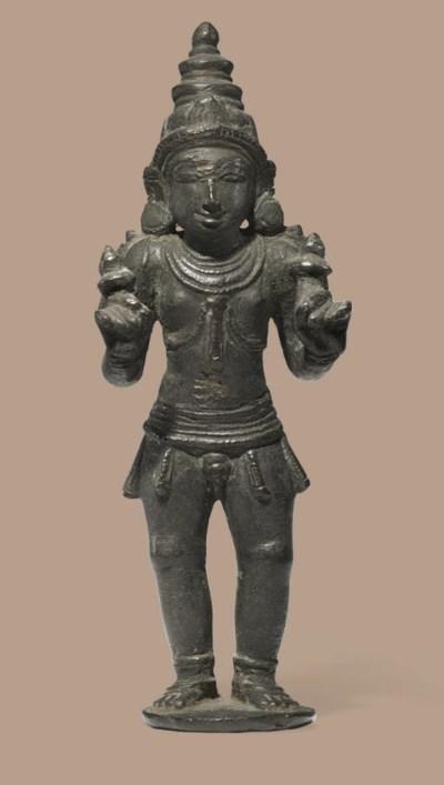A bronze figure of a Skanda