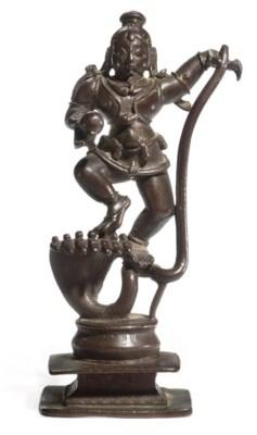 A copper figure of the Krishna