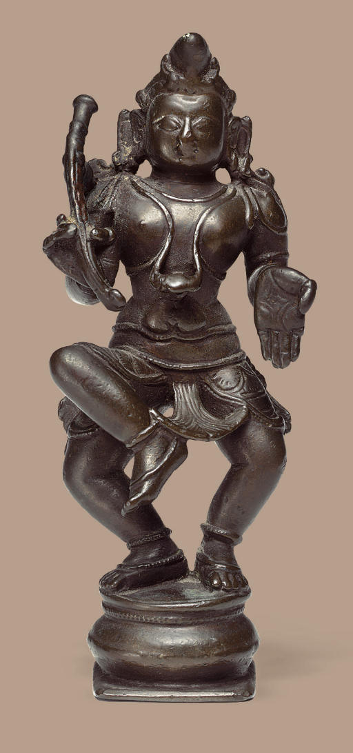 A copper figure of Krishna