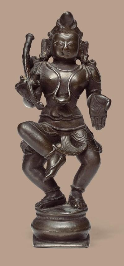 A copper figure of Krishna