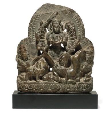 A gray stone figure of Durga