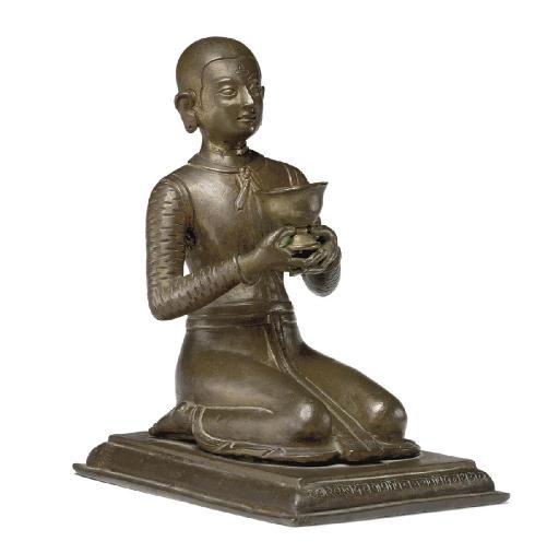 A copper figure of a kneeling