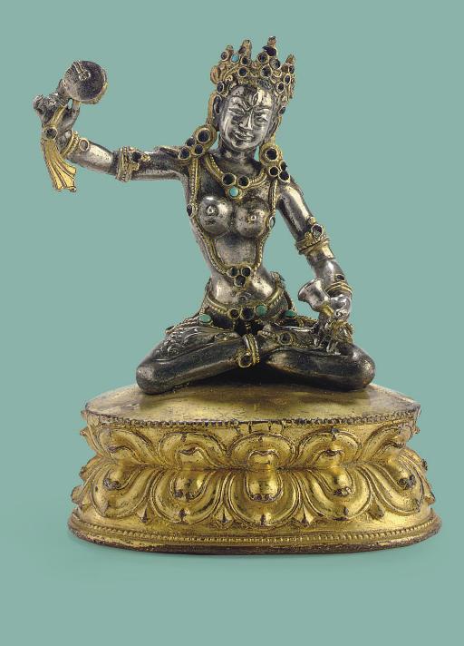 A silver and gilt copper figur