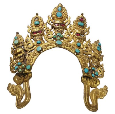 A gilt copper repousse crown o
