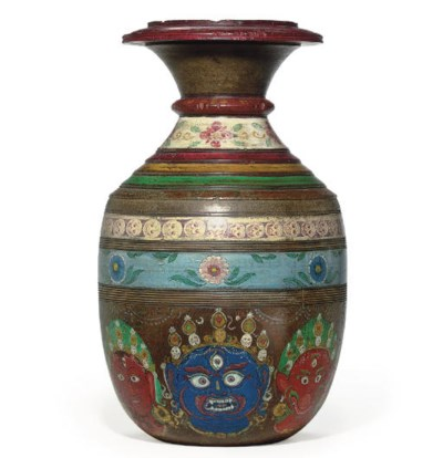 A painted wooden water pot wit