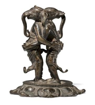 A rare bronze figure of embrac