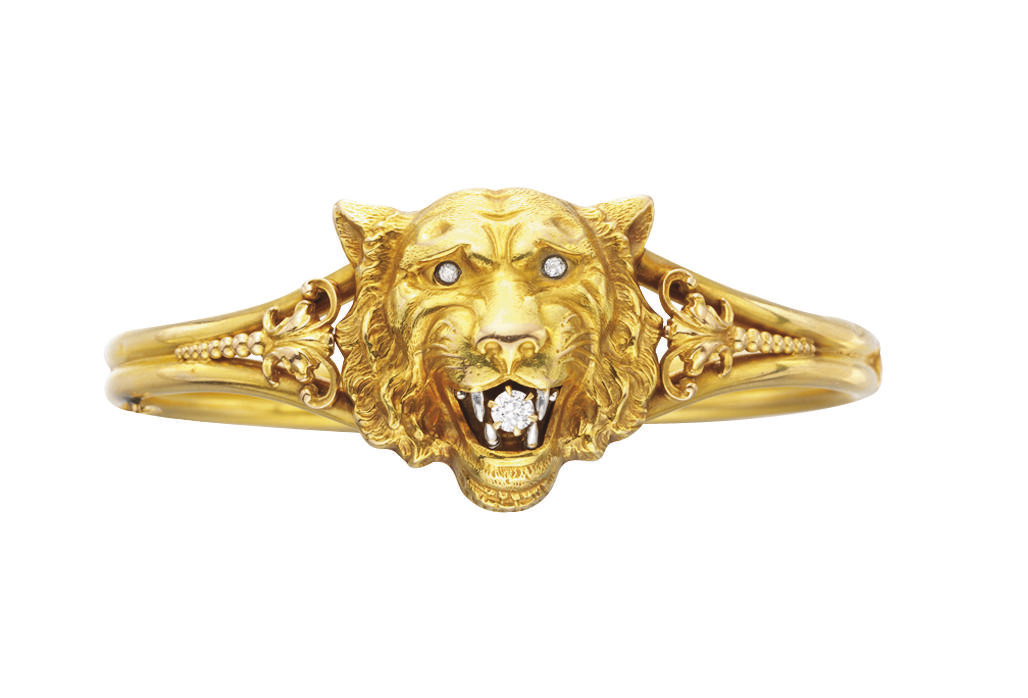 AN ANTIQUE GOLD AND DIAMOND BR