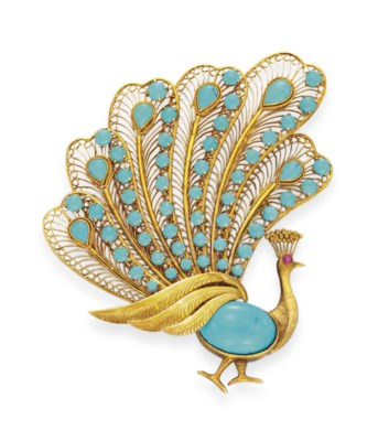 A TURQUOISE AND GOLD PEACOCK B