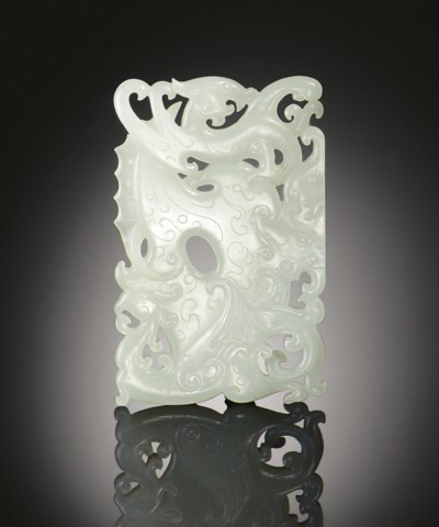 A FINELY CARVED WHITE JADE ARC