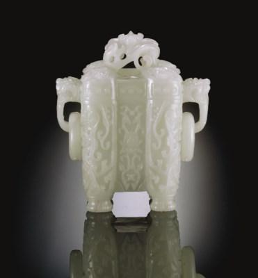 A WHITE JADE ARCHAISTIC VESSEL