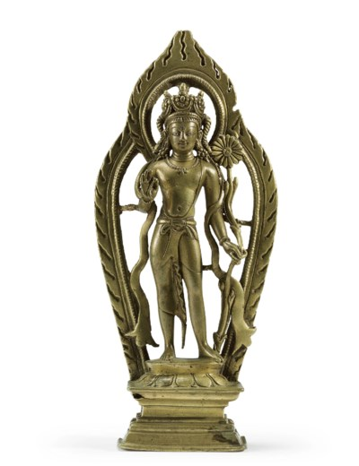 A silver inlaid brass figure o