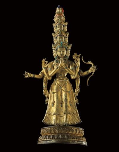 A hardstone inlaid gilt bronze