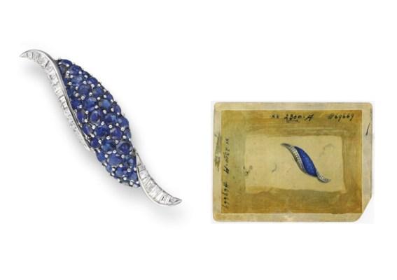 A SAPPHIRE AND DIAMOND SCROLL