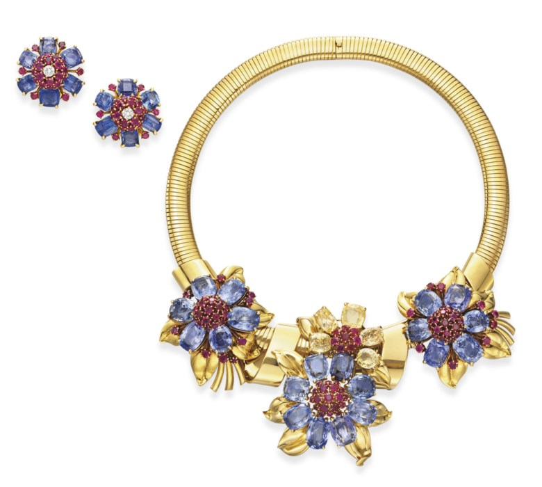 A suite of retro blue and yellow sapphire, ruby and gold Passe-Partout jewellery, by Van Cleef & Arpels. Sold for $86,500 on 15 October 2008  at Christie's in New York