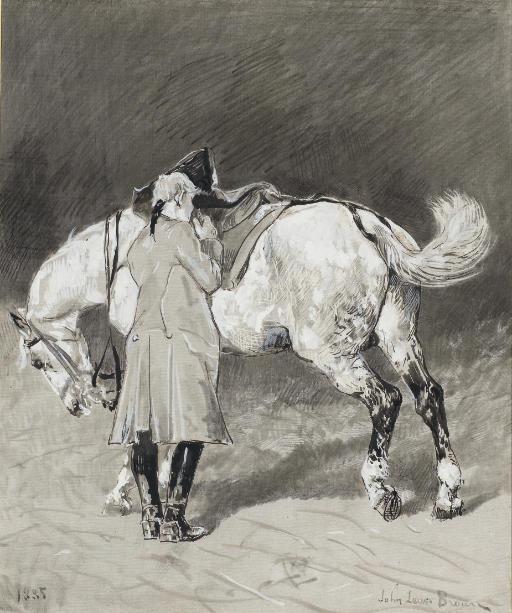 Un cavalier debout à côté de son cheval