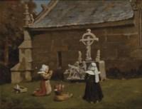 Femmes et enfant priant devant la croix
