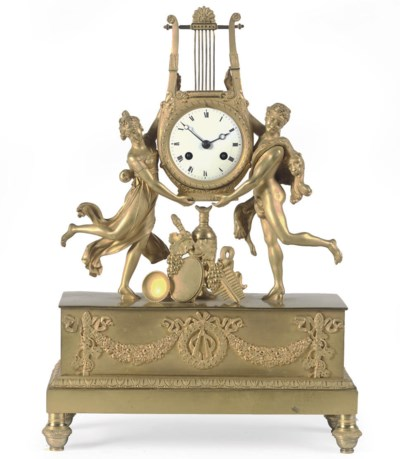 AN EMPIRE ORMOLU FIGURAL LYRE