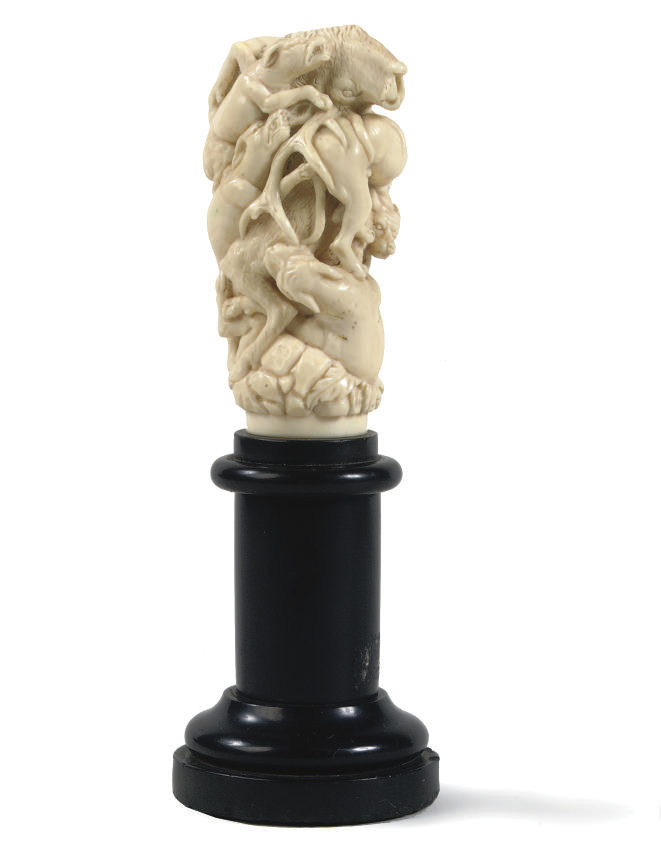 A CARVED IVORY GROUP OF HOUNDS