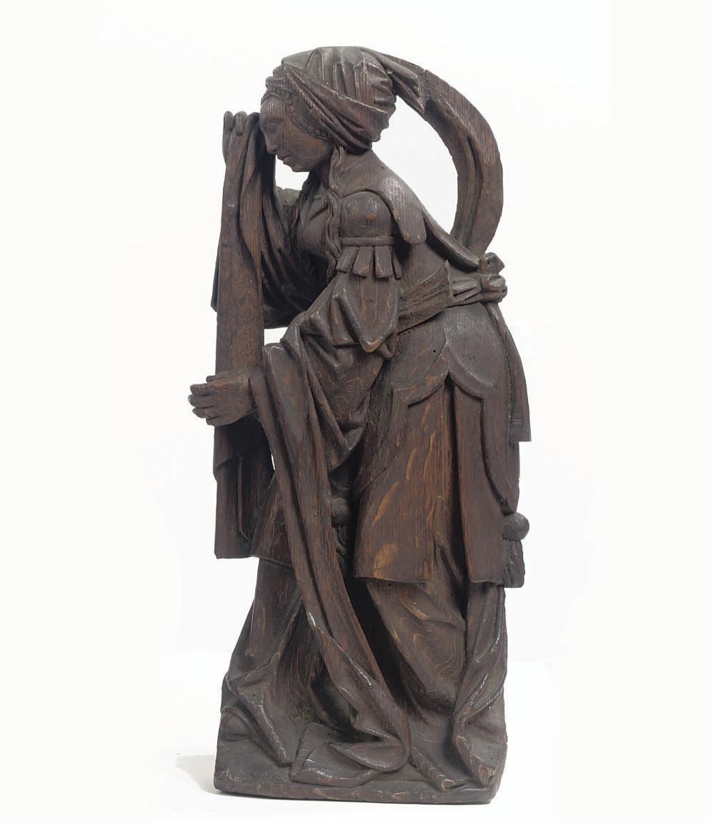 A CARVED OAK FIGURE OF MARY MA